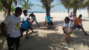Coach Nabil leading the stretching session the beach love Rasalkhaimah Astoria team @ Eta