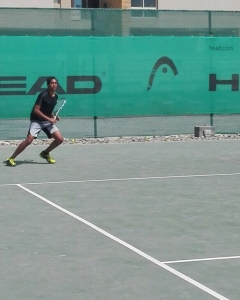 Recovery Parashar hit a defensive shot from forehand corner back to the center his eyes on the ball of protecting the backhand corner posture done