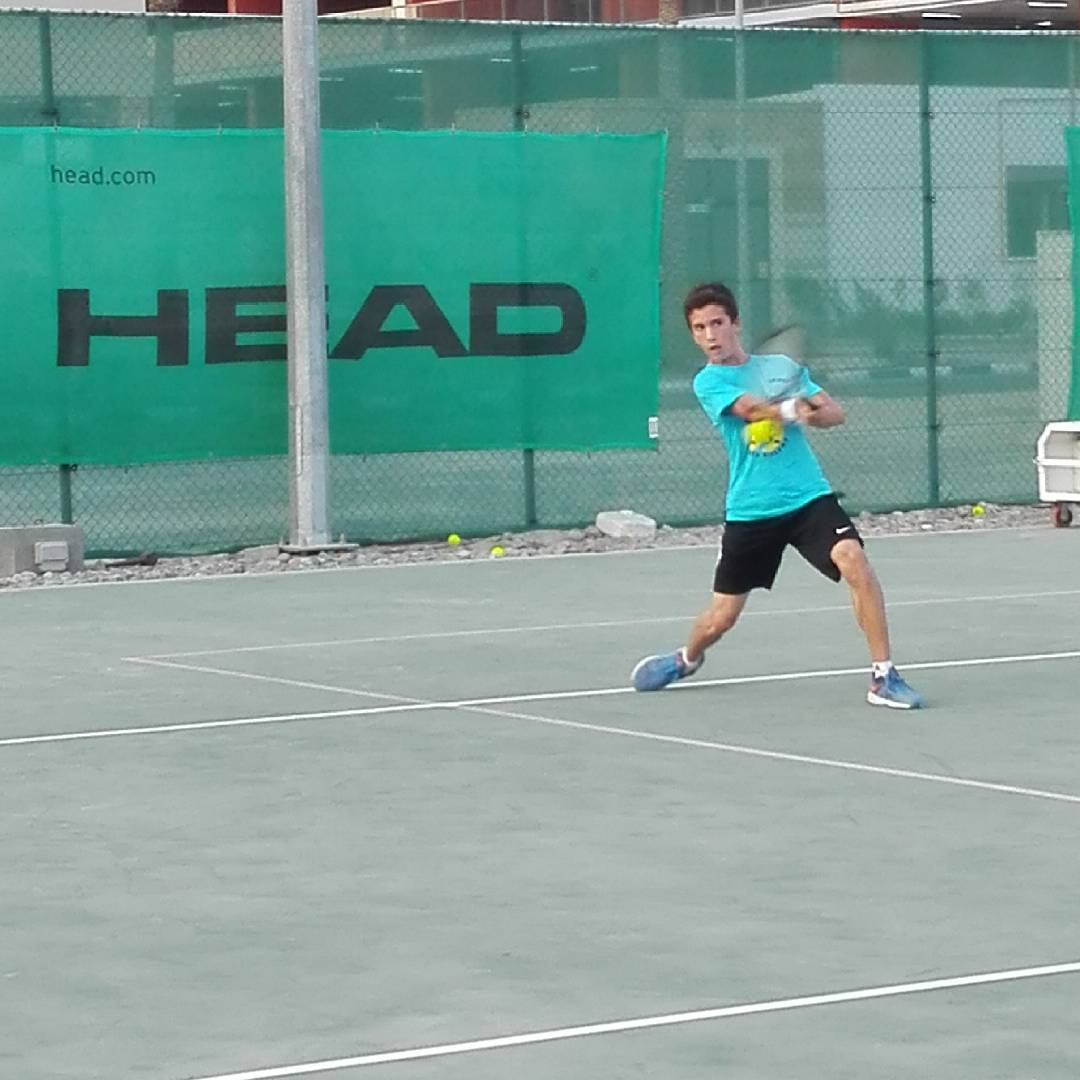 Tiber hitting a forehand with Emirates tennis Academy up now
